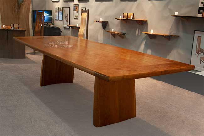 solid cherry conference table with hand fit breadboard ends from one end showing leg
